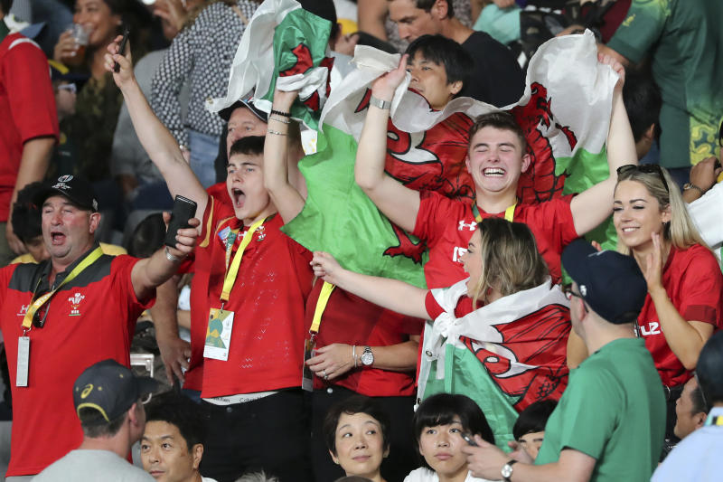 Wales fans celebrate after the Rugby World Cup Pool D game at Tokyo Stadium between Australia and Wales in Tokyo, Japan, Sunday, Sept. 29, 2019. (AP Photo/Koji Sasahara)