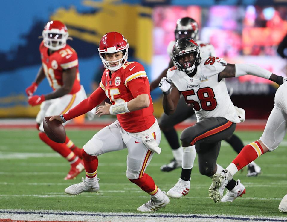 Kansas City Chiefs quarterback Patrick Mahomes is chased by Tampa Bay Buccaneers outside linebacker Shaquil Barrett (58) in the second half of the Chiefs' 31-9 loss in Super Bowl LV at Raymond James Stadium in Tampa, Fla. on Feb. 7, 2021.