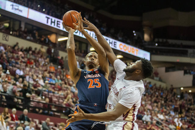 Virginia forward Mamadi Diakite (25) shoots next to Florida State forward RaiQuan Gray (1) during the first half of an NCAA college basketball game in Tallahassee, Fla., Wednesday, Jan. 15, 2020. (AP Photo/Mark Wallheiser)