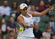 Australia's Ashleigh Barty plays a return to Czech Republic's Katerina Siniakova during the women's singles third round match on day six of the Wimbledon Tennis Championships in London, Saturday July 3, 2021. (AP Photo/Alastair Grant)
