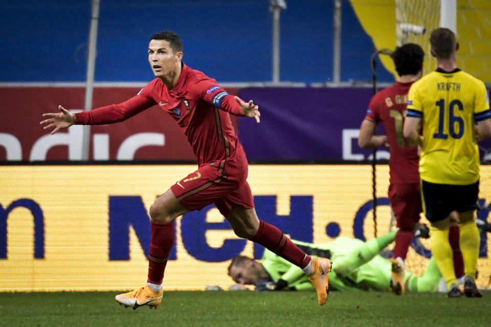FILE - In this Sept. 8, 2020 file photo Portugal's Cristiano Ronaldo celebrates after scoring against Sweden during their UEFA Nations League soccer match at Friends Arena in Stockholm, Sweden. The Portuguese soccer federation says on Tuesday, Oct. 13 Cristiano Ronaldo has tested positive for the coronavirus. The federation says Ronaldo is doing well and has no symptoms. He has been dropped from the country's Nations League match against Sweden on Wednesday. (Janerik Henriksson / TT via AP, file)