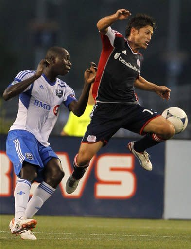 Montreal Impact midfielder Hassoun Camara, left, and New England Revolution midfielder Ryan Guy, right, right, vie for control of the ball during an MLS soccer match in Foxborough, Mass., Sunday, Aug. 12, 2012. (AP Photo/Steven Senne)