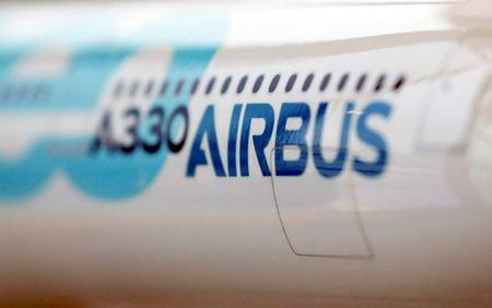 A scale model of an Airbus A330neo aircraft is pictured during its maiden flight event in Colomiers near Toulouse