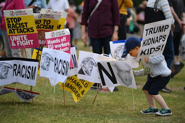 <p>A child walks around anti-Trump signs in Edinburgh during a visit by the president to Scotland on July 14, 2018. Trump, meanwhile, was at his Turnberry Luxury Collection Resort on Scotland's west coast. (Photo: Jeff J. Mitchell/Getty Images) </p>