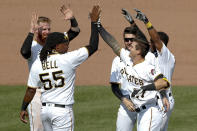 Pittsburgh Pirates' Kevin Newman (27) celebrates with Josh Bell (55) and other teammates after he drove in two runs with a game winning single in the ninth inning of a baseball game against the Minnesota Twins, Thursday, Aug. 6, 2020, in Pittsburgh. The Pirates won 6-5. (AP Photo/Keith Srakocic)