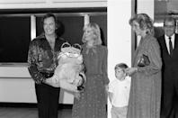 <p>While meeting Princess Diana ahead of his concert in 1984, Neil Diamond wore a sequin button-down shirt and black pants. He gifted the pregnant Princess with a toy Garfield. </p>