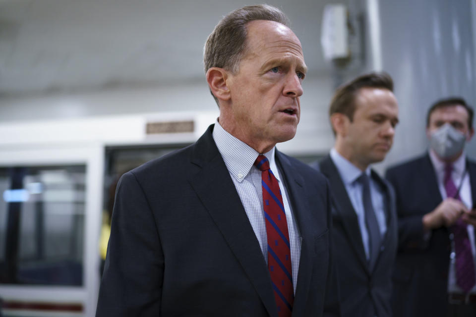 Sen. Pat Toomey, R-Pa., arrives for votes on amendments to advance the $1 trillion bipartisan infrastructure bill, at the Capitol in Washington, Wednesday, Aug. 4, 2021. (AP Photo/J. Scott Applewhite)