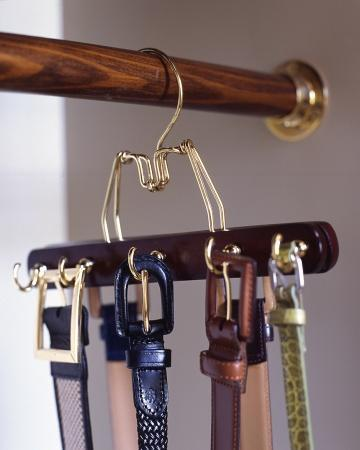 """<div class=""""caption-credit""""> Photo by: Martha Stewart Living</div><b>Matching Belt</b> <b>Rack</b> <br> To create a belt rack that matches your other hangers (and doesn't require making holes in the wall), try this: Predrill a row of holes in alternating spots on both sides of a wooden clamp hanger, and screw in cup hooks. Make as many of these hangers as you need to accommodate your belts. <br> <b>Related:</b> <br> <b><a href=""""http://www.marthastewart.com/275539/bedroom-decorating-ideas/@center/277006/bedroom-and-bathroom-decorating?xsc=synd_yshine"""" rel=""""nofollow noopener"""" target=""""_blank"""" data-ylk=""""slk:23 Ways to Decorate Your Bedroom"""" class=""""link rapid-noclick-resp"""">23 Ways to Decorate Your Bedroom</a> <br> <a href=""""http://www.marthastewart.com/275280/bathroom-organization-tips/@center/277006/bedroom-and-bathroom-decorating?xsc=synd_yshine"""" rel=""""nofollow noopener"""" target=""""_blank"""" data-ylk=""""slk:24 Ways to Organize Your Bathroom"""" class=""""link rapid-noclick-resp"""">24 Ways to Organize Your Bathroom</a></b> <br>"""