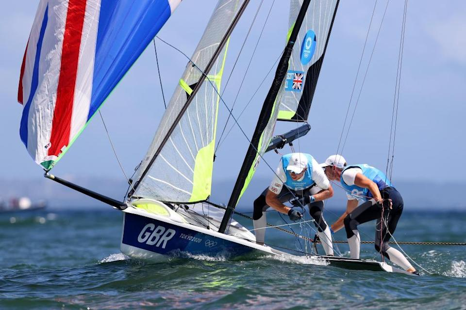 Dylan Fletcher and Stuart Bithell compete on their way to winning gold in the men's skiff 49er class.