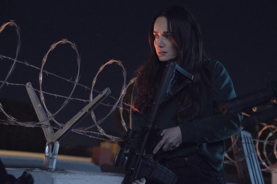 """This image released by Universal Pictures shows Ana de la Reguera in a scene from """"The Forever Purge,"""" directed by Everardo Valerio Gout. (Jake Giles Netter/Universal Pictures via AP)"""