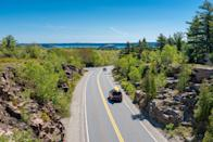 """<p><strong>The Drive:</strong> <a href=""""https://www.tripadvisor.com/Tourism-g143010-Acadia_National_Park_Mount_Desert_Island_Maine-Vacations.html"""" rel=""""nofollow noopener"""" target=""""_blank"""" data-ylk=""""slk:Acadia All-American Road"""" class=""""link rapid-noclick-resp"""">Acadia All-American Road</a></p><p><strong>The Scene:</strong> This three-hour, 40-mile trek offers spectacular coastal views where you'll see beaches, harbors, and lighthouses aplenty. Starting in <a href=""""https://www.tripadvisor.com/Tourism-g40926-Trenton_Maine-Vacations.html"""" rel=""""nofollow noopener"""" target=""""_blank"""" data-ylk=""""slk:Trenton, Maine"""" class=""""link rapid-noclick-resp"""">Trenton, Maine</a>, you'll drive down to Hulls Cove Visitor Center where you'll then start <a href=""""https://www.tripadvisor.com/Attraction_Review-g143010-d208151-Reviews-Park_Loop_Road-Acadia_National_Park_Mount_Desert_Island_Maine.html"""" rel=""""nofollow noopener"""" target=""""_blank"""" data-ylk=""""slk:the loop around Acadia National Park"""" class=""""link rapid-noclick-resp"""">the loop around Acadia National Park</a>.</p><p><strong>The Pit-Stop:</strong> Bring your hiking boots, so you can venture to the top of <a href=""""https://www.tripadvisor.com/Attraction_Review-g143010-d108269-Reviews-Cadillac_Mountain-Acadia_National_Park_Mount_Desert_Island_Maine.html"""" rel=""""nofollow noopener"""" target=""""_blank"""" data-ylk=""""slk:Cadillac Mountain"""" class=""""link rapid-noclick-resp"""">Cadillac Mountain</a> in <a href=""""https://www.tripadvisor.com/Tourism-g143010-Acadia_National_Park_Mount_Desert_Island_Maine-Vacations.html"""" rel=""""nofollow noopener"""" target=""""_blank"""" data-ylk=""""slk:Acadia National Park"""" class=""""link rapid-noclick-resp"""">Acadia National Park</a>. It's the highest peak on the east coast and offers incredible views of water. </p>"""