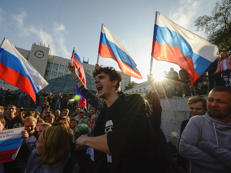 Happy birthday: nationwide demonstrations, including this one in Vladivostok, greeted Vladimir Putin: Reuters