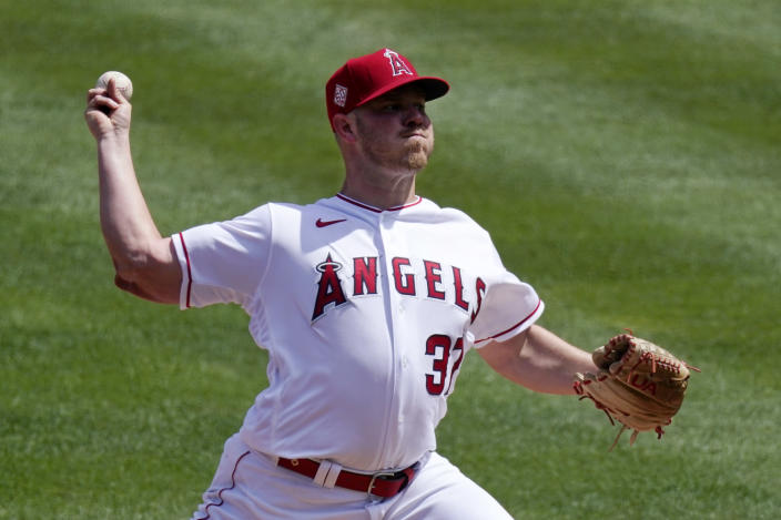 Los Angeles Angels starting pitcher Dylan Bundy throws to the plate during the first inning of a baseball game against the Houston Astros Tuesday, April 6, 2021, in Anaheim, Calif. (AP Photo/Mark J. Terrill)