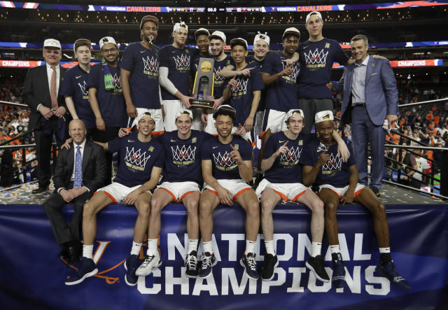 FILE- In this April 8, 2019, file photo, Virginia players celebrate after the championship game against Texas Tech in the Final Four NCAA college basketball tournament in Minneapolis. Virginia won 85-77 in overtime. (AP Photo/David J. Phillip, File)