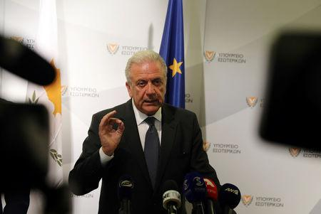 European Commissioner for Migration, Home Affairs and Citizenship Dimitris Avramopoulos talk during a news conference in Nicosia