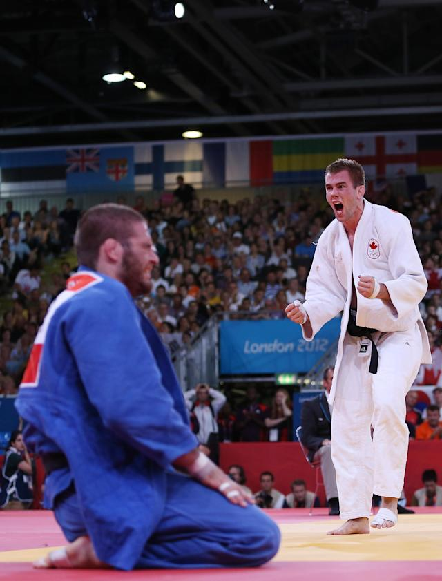 LONDON, ENGLAND - JULY 31: Antoine Valois-Fortier of Canada reacts to defeating Travis Stevens of the United States in the Men's -81 kg Judo on Day 4 of the London 2012 Olympic Games at ExCeL on July 31, 2012 in London, England. (Photo by Quinn Rooney/Getty Images)