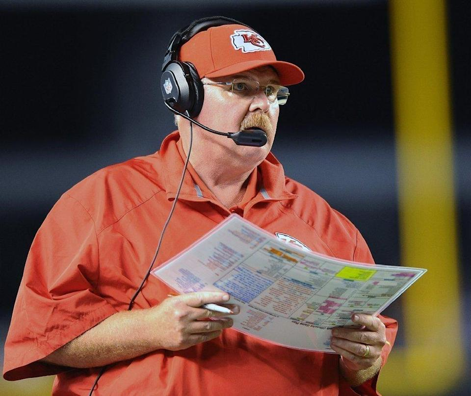 Chiefs coach Andy Reid checks his play sheet.