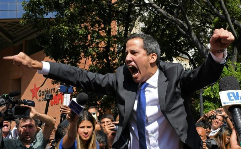 Venezuelan opposition leader and self-proclaimed acting president Juan Guaido shouts on his way to the National Assembly, in Caracas, on January 7, 2020, where he claimed the speaker's chair