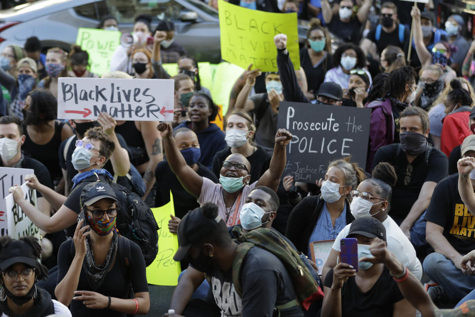 Protesters gather to protest the death of George Floyd and Breonna Taylor, Friday, May 29, 2020, in Louisville, Ky. Taylor, a black woman, was fatally shot by police in her home in March. (AP Photo/Darron Cummings)