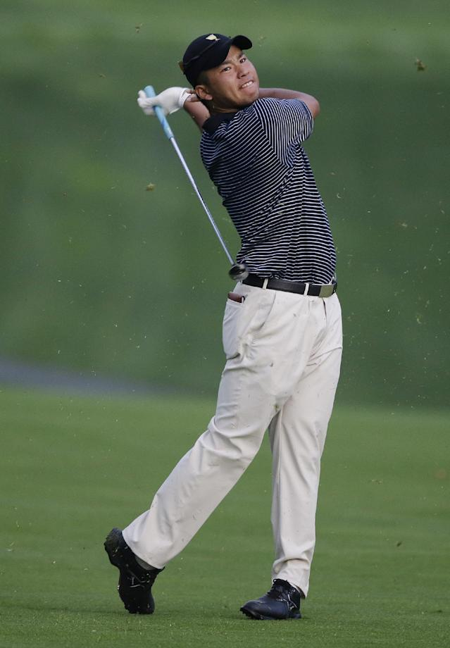 International team player Hideki Matsuyama, of Japan, watches his second shot on the 11th hole during a foursome match at the Presidents Cup golf tournament at Muirfield Village Golf Club Friday, Oct. 4, 2013, in Dublin, Ohio. (AP Photo/Darron Cummings)