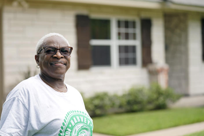 Doris Brown poses for a photograph outside her home Friday, July 31, 2020, in Houston. Brown's home flooded during Harvey and she's part of a group called the Harvey Forgotten Survivors Caucus. (AP Photo/David J. Phillip)