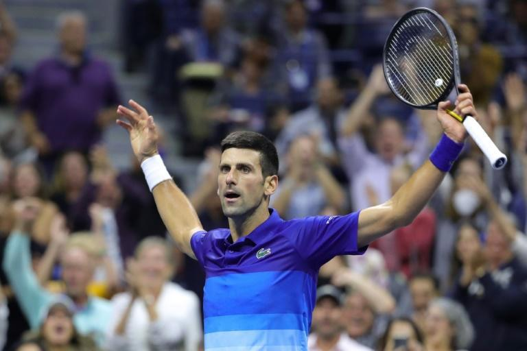Serbia's Novak Djokovic reached the brink of completing the first men's singles calendar-year Grand Slam since 1969 by defeating Alexander Zverev on Friday to reach the US Open final (AFP/Kena Betancur)