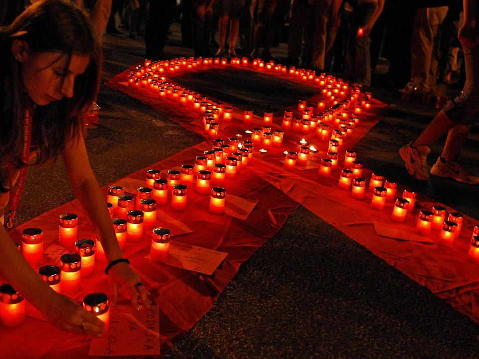 The red ribbon, seen here in Belgrade, has become a symbol for Aids around the world after O'Connell saw the PR potential of involving celebrities with their campaignAFP/Getty