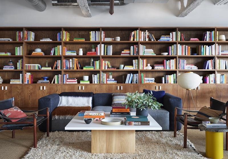 The library was designed for focused quiet work and is wrapped in bookcases. (One bookcase is the entrance to the speakeasy.)