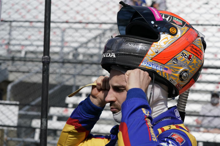 Alexander Rossi puts on his helmet during practice for the Indianapolis 500 auto race at Indianapolis Motor Speedway, Wednesday, May 19, 2021, in Indianapolis. (AP Photo/Darron Cummings)