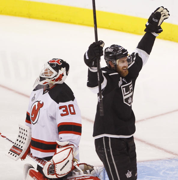 Los Angeles Kings center Jeff Carter celebrates after scoring against New Jersey Devils goalie Martin Brodeur (30) in the second period during Game 6 of the NHL hockey Stanley Cup finals, Monday, June 11, 2012, in Los Angeles. (AP Photo/Jae C. Hong)