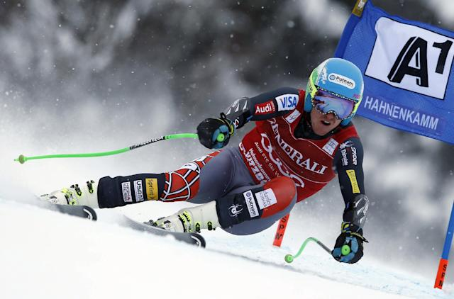 Ted Ligety, of the US, speeds down the slope on his way to take second place in an alpine ski men's World Cup super-combined, in Kitzbuehel, Austria, Sunday, Jan. 26, 2014. (AP Photo/Shinichiro Tanaka)