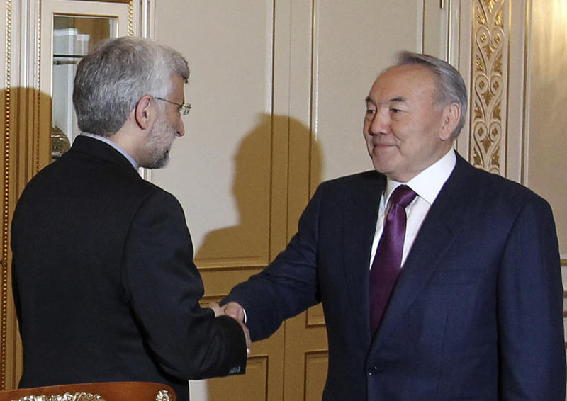 Chief Iranian nuclear negotiator Saeed Jalili, left, shakes hands with Kazakhstan's President Nursultan Nazarbayev prior their talks in Almaty, Kazakhstan, Monday, Feb. 25, 2013. Iran and six world powers, five permanent U.N. Security council members and Germany, are set to hold talks in Kazakhstan this week on Tehran's controversial nuclear program.(AP Photo/Pavel Mikheyev)