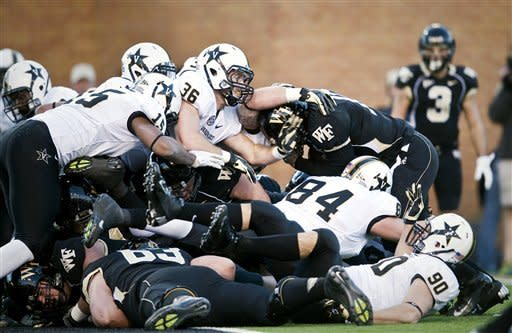 Wake Forest quarterback Tanner Price (10) is stopped at the goal line during an NCAA college football game against Vanderbilt on Saturday, Nov. 24, 2012, in Winston-Salem, N.C. (AP Photo/Winston-Salem Journal, Andrew Dye)