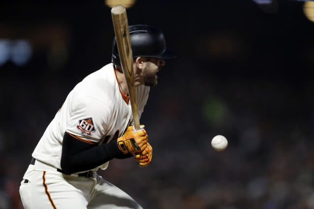 San Francisco Giants' Evan Longoria is hit by a pitch during the third inning of a baseball game against the Washington Nationals Tuesday, April 24, 2018, in San Francisco. (AP Photo/Marcio Jose Sanchez)