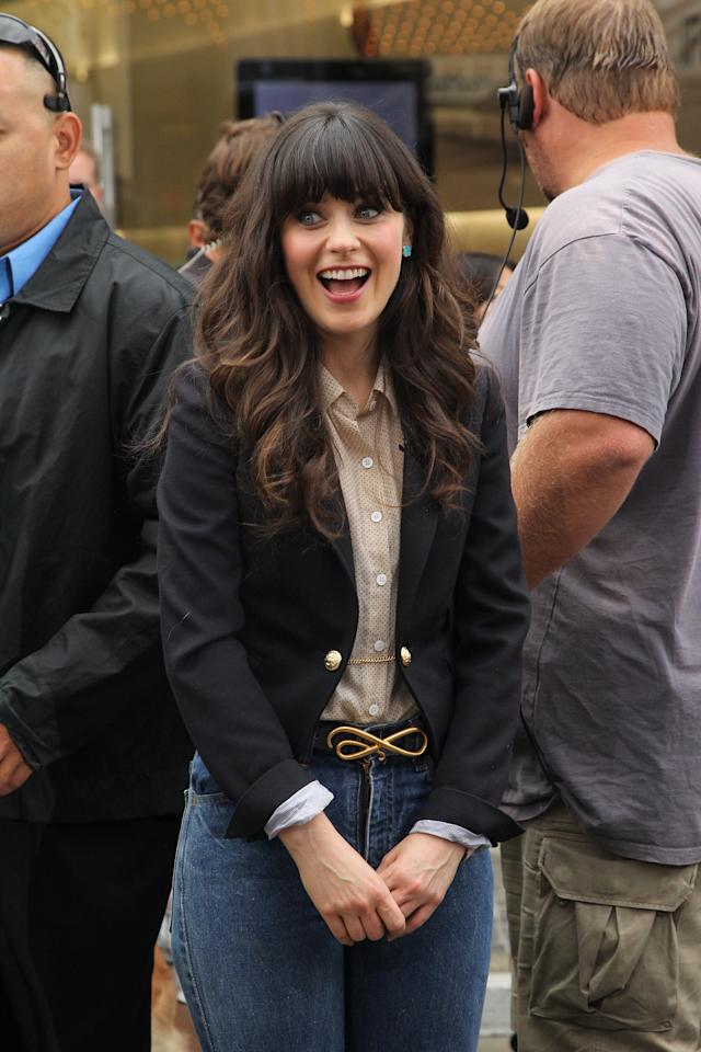 LOS ANGELES, CA - OCTOBER 04:  Zooey Deschanel visits Extra at The Grove on October 4, 2011 in Los Angeles, California.  (Photo by Noel Vasquez/Getty Images for Extra)