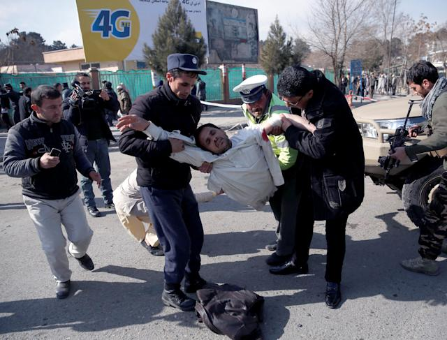 <p>People carry an injured man after a blast in Kabul, Afghanistan, Jan. 27, 2018. (Photo: Mohammad Ismail/Reuters) </p>