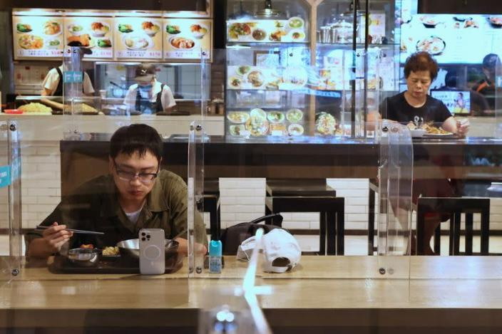 People eat lunch between plastic partitions following the outbreak of coronavirus disease (COVID-19), in Taipei,