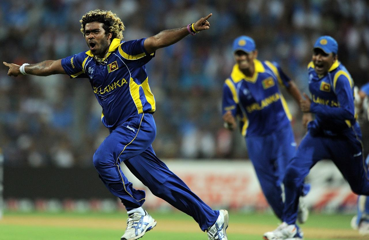 Sri Lankan fastbowler Lasith Malinga (L) reacts after taking the wicket of Indian cricketer Sachin Tendulkar during the ICC Cricket World Cup 2011 Final match at The Wankhede Stadium in Mumbai on April 2, 2011. AFP PHOTO/MANAN VATSYAYANA (Photo credit should read MANAN VATSYAYANA/AFP/Getty Images)