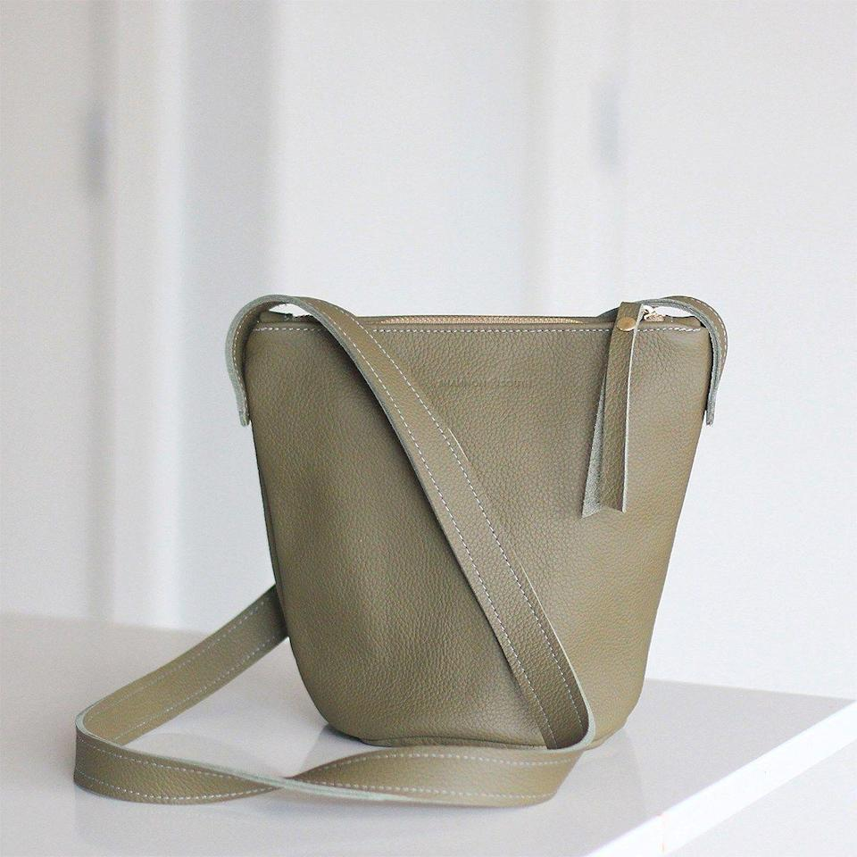 """<p><strong>Remade USA</strong></p><p>remadeusa.com</p><p><strong>$140.00</strong></p><p><a href=""""https://remadeusa.com/product/norman-bucket-bag/"""" rel=""""nofollow noopener"""" target=""""_blank"""" data-ylk=""""slk:SHOP IT"""" class=""""link rapid-noclick-resp"""">SHOP IT</a></p><p>Remade USA takes leather jackets and repurposes them into a handbag that suits any season. This bucket bag will be the go-to you'll grab for years.</p>"""