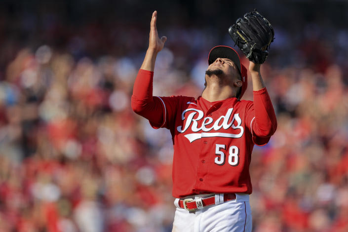 Cincinnati Reds' Luis Castillo reacts as he leaves the field during the seventh inning of a baseball game against the Atlanta Braves in Cincinnati, Saturday, June 26, 2021. (AP Photo/Aaron Doster)