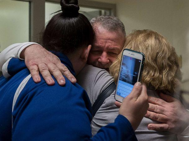 PHOTO: Ricky Davis is released from custody and hugs mom, Maureen Klein, right, and another family member at the El Dorado County Jail after he was exonerated in the 1985 murder of Jane Hylton on Feb. 13, 2020. (Paul Kitagaki Jr./Sacramento Bee via ZUMA Wire via Newscom)