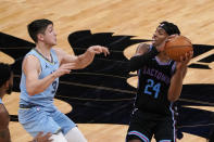 Sacramento Kings guard Buddy Hield, right, looks to pass against Memphis Grizzlies guard Grayson Allen during the first half of an NBA basketball game in Sacramento, Calif., Sunday, Feb. 14, 2021. (AP Photo/Rich Pedroncelli)