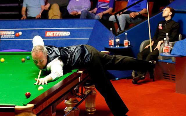 John Higgins on his way to beating young pretender Judd Trump - PA