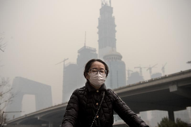 Growing public unhappiness with the choking pollution that regularly blankets parts of China is helping to drive the shift from fossil fuels to renewables (AFP Photo/NICOLAS ASFOURI)