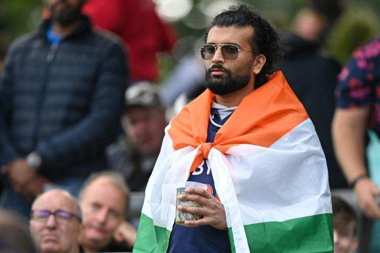True colours: An India supporter draped in the country's flag, looks on during the first day of the fourth Test against England at the Oval on Thursday (AFP/DANIEL LEAL-OLIVAS)