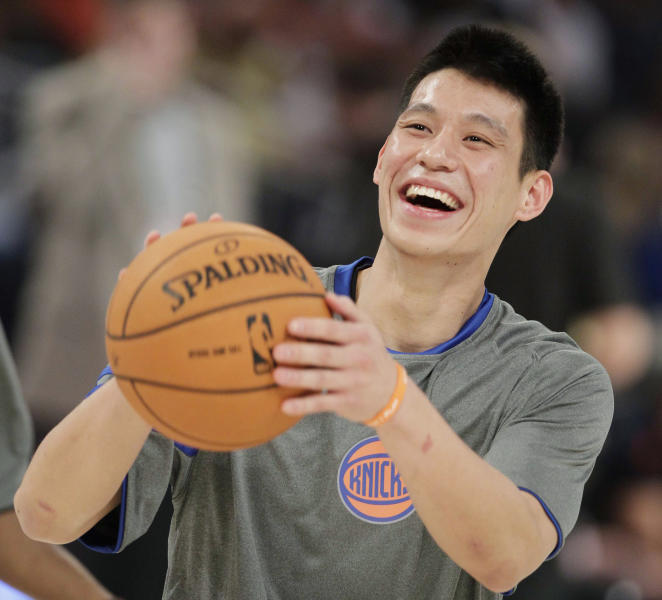 FILE - This Feb. 24, 2012 file photo shows New York Knicks' Jeremy Lin laughing during warmups before the start of the NBA All-Star Rising Stars Challenge basketball game in Orlando, Fla. This would have been such an easy decision in February. Lin was the biggest thing in basketball, and no way the Knicks would have let him go elsewhere. Now, knowing his price and with no assurance he'll play as he did when Linsanity reigned, the Knicks may allow Lin to leave for Houston. (AP Photo/Chris O'Meara, File)