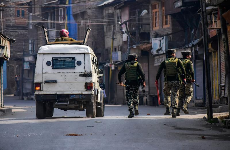 Paramilitary troopers patrol a street during clashes on October 29, 2019.