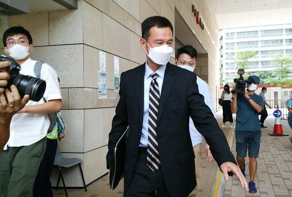 Superintendent Simon Cheung leaves West Kowloon Court after testifying against Chow Hang-tung on Wednesday. Photo: Brian Wong