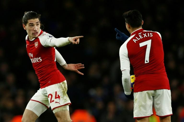 Arsenal's Hector Bellerin (L) celebrates after scoring a goal with teammate Alexis Sanchez during their English Premier League match against Chelsea, at the Emirates Stadium in London, on January 3, 2018