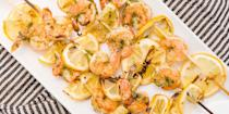 """<p>These three-ingredient skewers—shrimp, pesto, and lemon—are easy enough for a weeknight or classy enough for guests.</p><p>Get the recipe from <a href=""""https://www.delish.com/cooking/recipe-ideas/recipes/a43681/pesto-shrimp-skewers-recipe/"""" rel=""""nofollow noopener"""" target=""""_blank"""" data-ylk=""""slk:Delish"""" class=""""link rapid-noclick-resp"""">Delish</a>.</p>"""